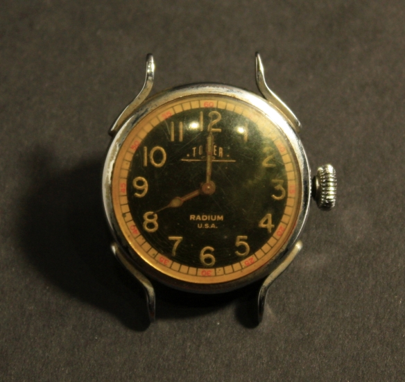 A watch with radium paint on the numbers and hands.
